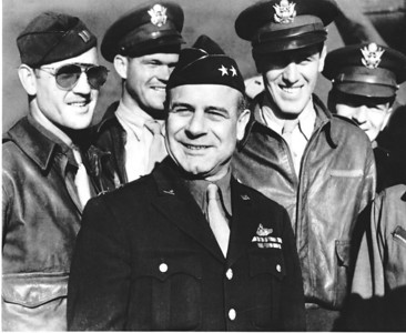 """General Jimmy Doolittle (center), flanked by other Army Air Corps officers -- all believed to be members of the famous Doolittle Raiders..  In fact, we believe the tall fellow (fourth from the left in this photograph) was the other South Dakotan involved with the Raiders,  Lieutenant Henry """"Hank"""" Potter.  While only Doolittle was identified in this photo, we've seen several other pictures of Potter (including the one above), and this appears to be him.   Potter was born in Pierre and later attended Yankton College.  He was the navigator for Doolittle's #1 aircraft, which was the first bomber to drop bombs on Tokyo during the 1942 raid.  (Air Force photo)"""