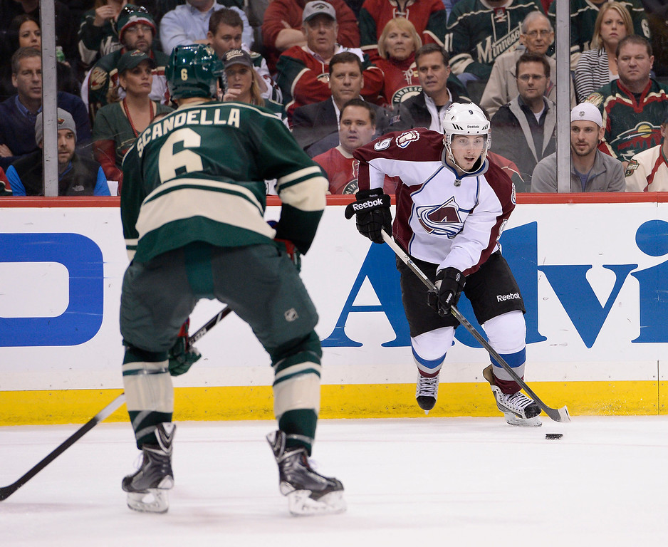 . Colorado Avalanche center Matt Duchene (9) looks to pass the puck during the seoncd period against the Minnesota Wild April 28, 2014 in Game 6 of the Stanley Cup Playoffs at Xcel Energy Center.  (Photo by John Leyba/The Denver Post)