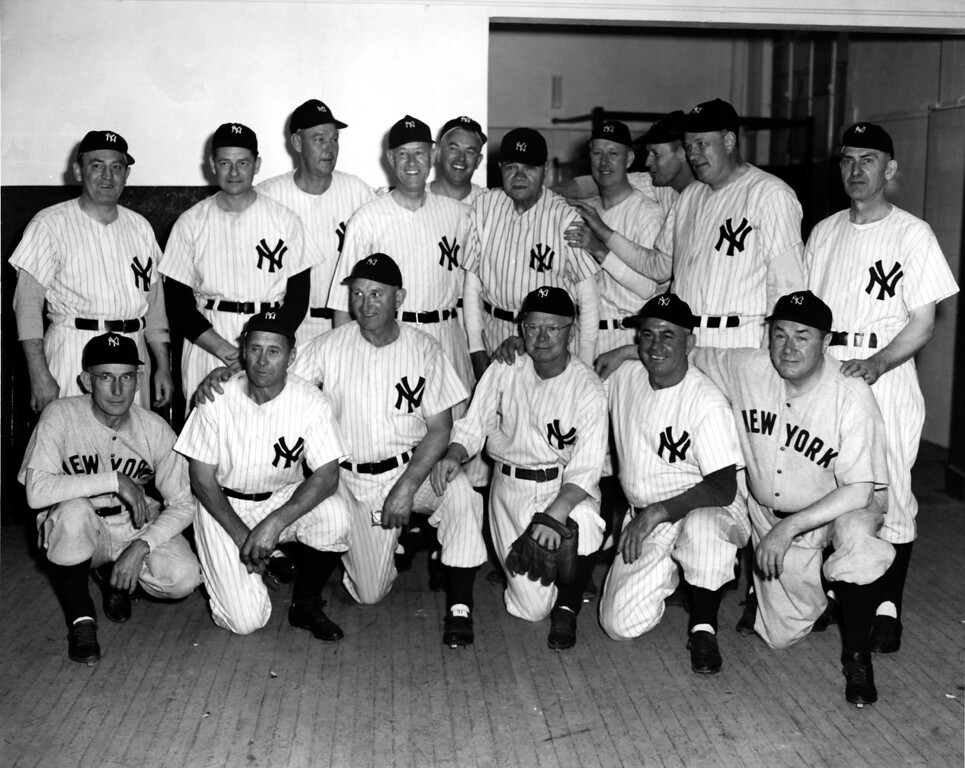 . BRONX, NY - JUNE 13:  The 1923 New York Yankees pose for a team portrait during the 25th anniversary celebration of the opening of Yankee Stadium on June 13, 1948 in the Bronx, New York.  The players from (L-R) top row, Hinkey Haines, Waite Hoyt, George Pipgras, Joe Bush, Oscar Roettger, Babe Ruth, Bob Meusel, Joe Dugan, Wally Pipp, Elmer Smith, bottom row, Sam Jones, Wally Schang, Carl Mays, Whitey Witt, Fred Hofmann and Mike McNally.  They all played a two inning game today.  (Photo by Keystone/Hulton Archive/Getty Images)