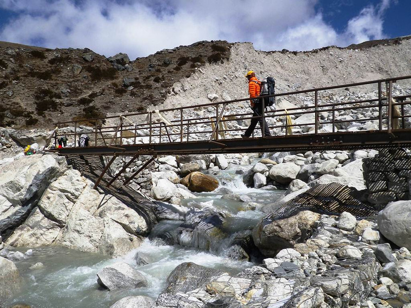 Nima Kancha Sherpa on the bridge just below end of Khumbu glacier.