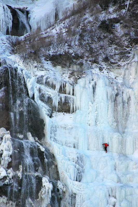 DAY 12 - I took Sonja for a drive up Provo Canyon. Our first stop was Bridal Veil Falls. There were at least 5 ice climbers on the falls. This guy looked like he was climbing solo.