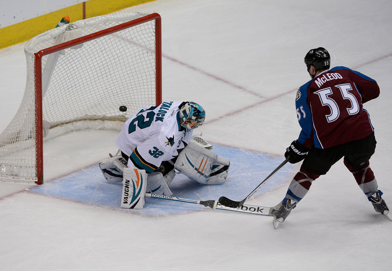 . Cody McLeod, right, Colorado Avalanche left wing, scores a short-handed goal against, San Jose Sharks goalie, Alex Stalock, in the first period of play at the Pepsi Center Saturday afternoon, March 29, 2014. (Photo By Andy Cross / The Denver Post)