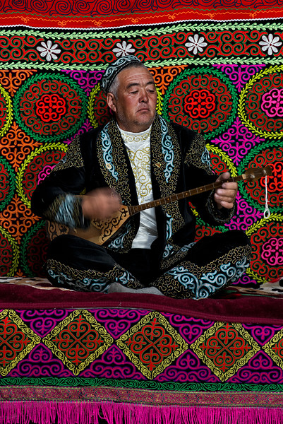 Sometimes in the winter when temperatures can drop below 40 degrees celsius, Mr Shamurat likes playing on his traditional Dombra.