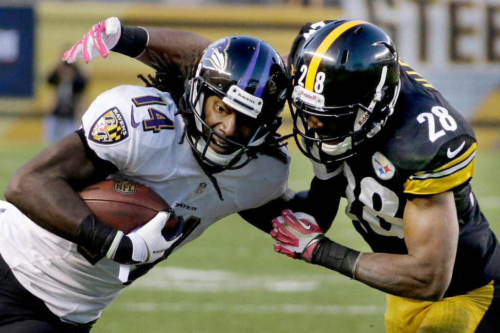 . Baltimore Ravens wide receiver Marlon Brown (14) is tackled by Pittsburgh Steelers cornerback Cortez Allen (28) in the third quarter of an NFL football game in Pittsburgh on Sunday, Oct. 20, 2013. (AP Photo/Gene J. Puskar)