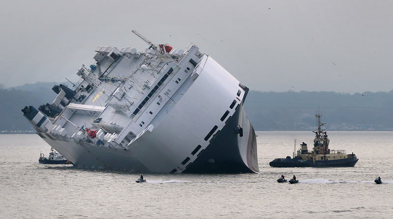 . Jet skiiers pass the stricken vessel \'The Hoegh Osaka\' which ran aground on a sand bank in the Solent on January 4, 2015 in Cowes, England. The cargo ship ran aground on Bramble Bank after leaving Southampton bound for Germany. All 25 crew members were rescued overnight.  (Photo by Peter Macdiarmid/Getty Images)