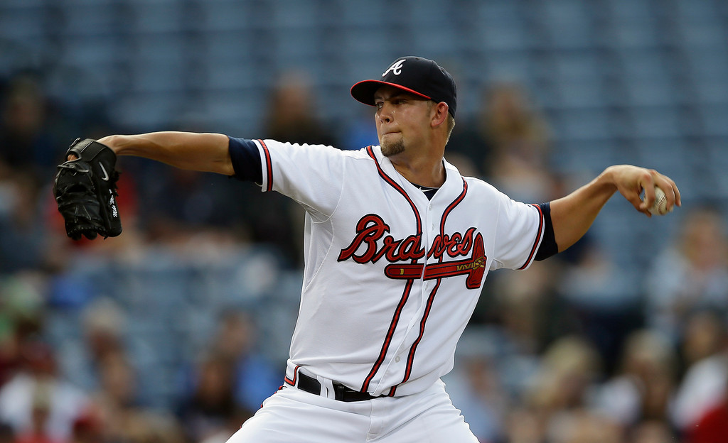 . Atlanta Braves starting pitcher Mike Minor works in the first inning of a baseball game against the Colorado Rockies in Atlanta, Wednesday, July 31, 2013. (AP Photo/John Bazemore)