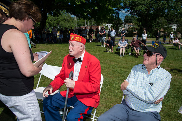 05/27/19 Wesley Bunnell | Staff Bristol held Memorial Day ceremonies on Monday morning ending with a ceremony which presented World War II veterans with All Heart Awards from the city. USMC veteran George Burns is about to receive his award from Mayor Ellen Zoppo-Sassu as Navy veteran James Cleveland looks on.