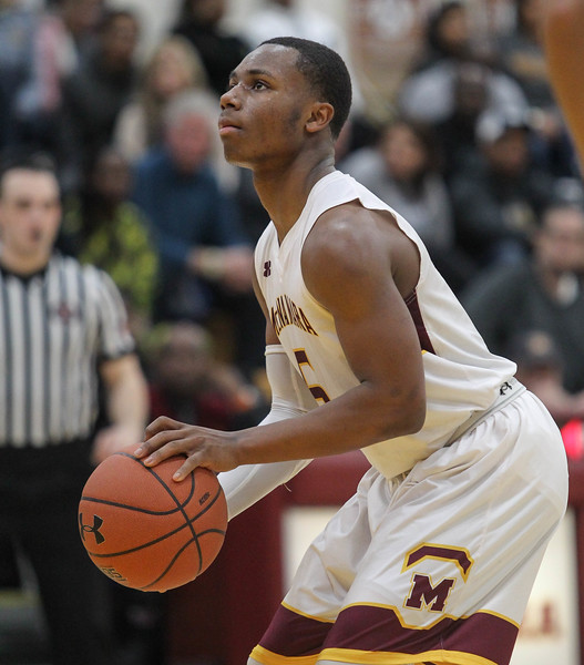 """February 2, 2019: McNamara guard Kenny Womack (5) shoots the game winning free throws during HS boys basketball action between Bishop O'Connell HS and Bishop McNamara HS in Forestville. Photo by: Chris Thompkins/Prince George""""s Sentinel"""