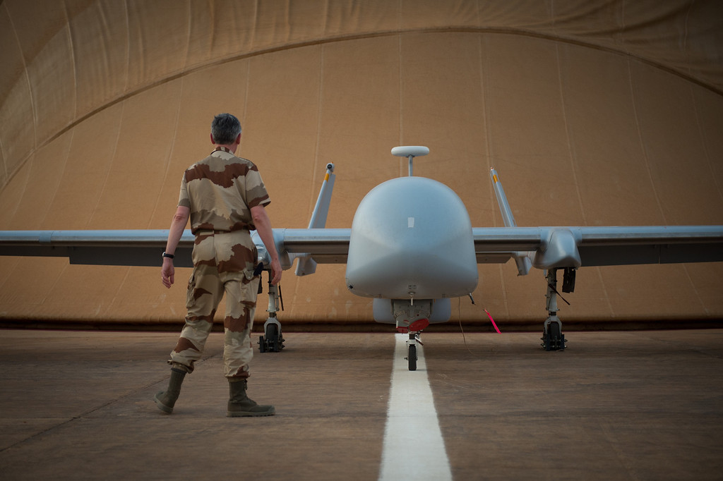 . A French soldier of the Serval operation in Mali stands in front of a Harfang drone on April 26, 2013 on the French army base of Niamey. MARTIN BUREAU/AFP/Getty Images