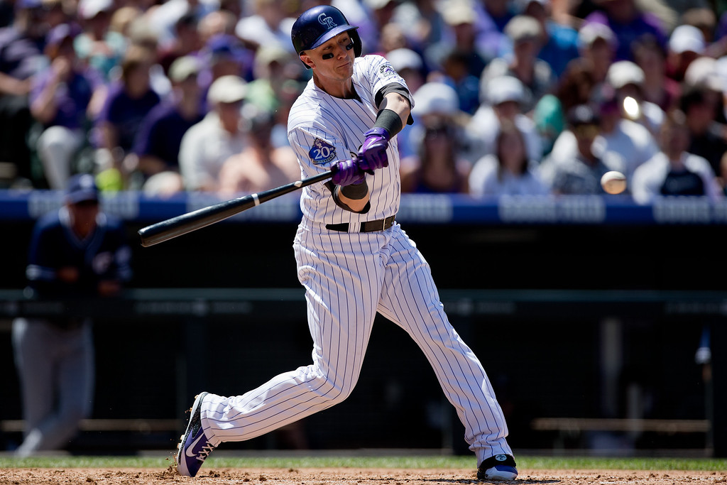 . Troy Tulowitzki #2 of the Colorado Rockies hits an RBI single during the third inning against the San Diego Padres at Coors Field on August 14, 2013 in Denver, Colorado.  The Rockies defeated the Padres 4-2.  (Photo by Justin Edmonds/Getty Images)
