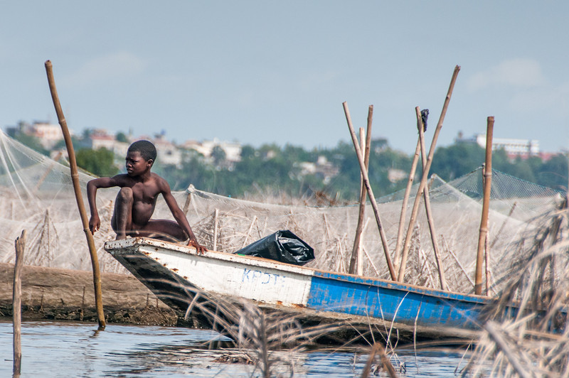 Child fishing in Cotonou, Benin