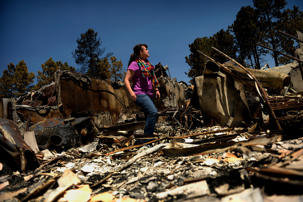 . COLORADO SPRINGS, CO. - June 19: Camla Schultz looking for anything that could have survived in the rubble of her families home of 8 years as more residents were allowed back to see their homes that were burned in the Black Forest Fire area near Colorado Springs, Colorado. June 19, 2013 Colorado Springs. (Photo By Joe Amon/The Denver Post)