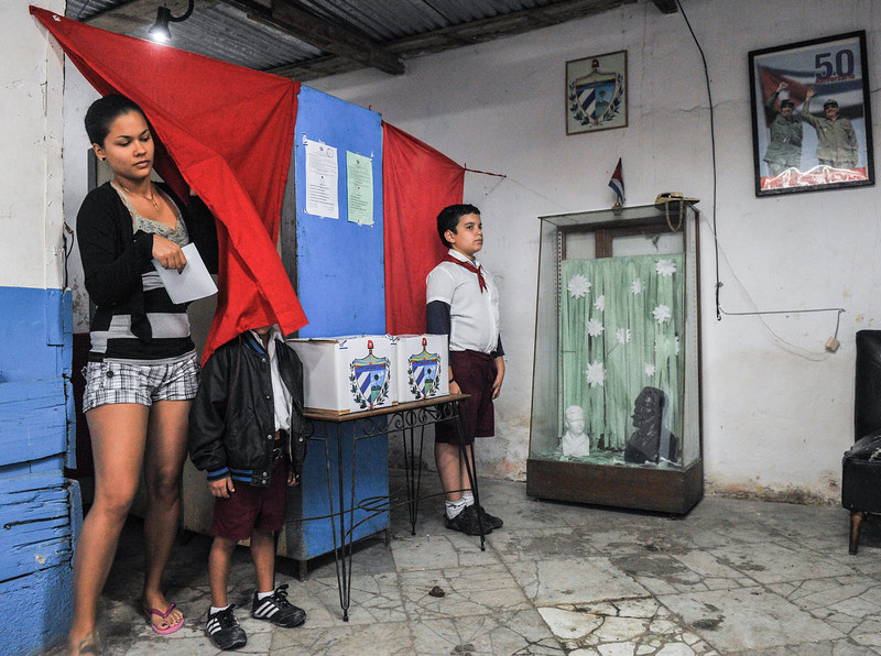 . A Cuban leaves the booth after casting her vote at a polling station in Havana on February 3, 2013. Cubans on Sunday elected provincial delegates to to the People\'s Power assemblies and parliamentary deputies. AFP PHOTO / STR/AFP/Getty Images