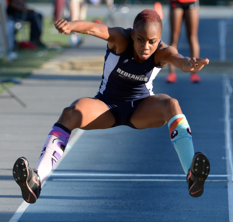 . Redland\'s Juanita Webster competes in the Triple Jump during the CIF-SS Masters Track and Field meet at Falcon Field on the campus of Cerritos College in Norwalk, Calif., on Friday, May 30, 2014.   (Keith Birmingham/Pasadena Star-News)