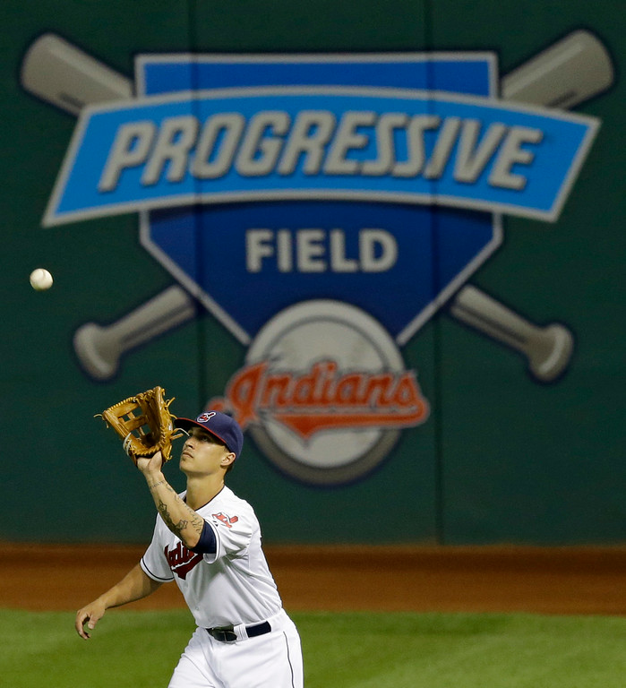 . Cleveland Indians\' Zack Walters catches a fly ball hit by Detroit Tigers\' Eugenio Suarez in the fifth inning of a baseball game, Wednesday, Sept. 3, 2014, in Cleveland. Suarez was out on the play. (AP Photo/Tony Dejak)