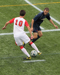 POUGHKEEPSIE, NY - SEPTEMBER 26: Marist Mens Soccer verses La Salle at Marist College on September 26, 2010 in Poughkeepsie New York.  Marist's #10 Krystian Witkowski slides by La Salle defender on the way to a Marist 4-2 victory. Photo by Sandy Tambone
