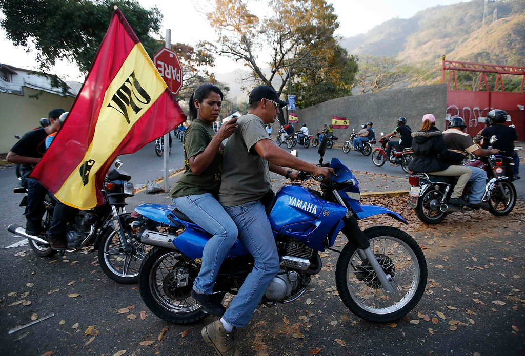 . Supporters of Venezuela\'s President Hugo Chavez ride on motobikes through the city as a reaction to the announcement of his death in Caracas, March 5, 2013. Chavez has died after a two-year battle with cancer, ending the socialist leader\'s 14-year rule of the South American country, Vice President Nicolas Maduro said in a televised speech on Tuesday.    REUTERS/Jorge Silva