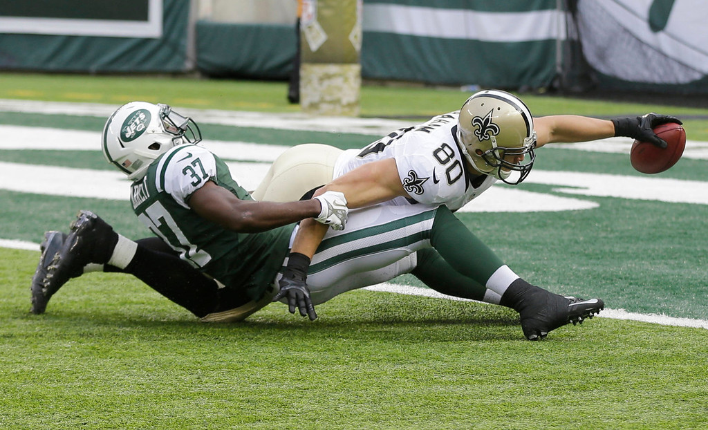 . New Orleans Saints tight end Jimmy Graham (80) dives forward for a touchdown as New York Jets free safety Jaiquawn Jarrett (37) attempts to stop him during the first half of an NFL football game Sunday, Nov. 3, 2013, in East Rutherford, N.J.  (AP Photo/Mel Evans)