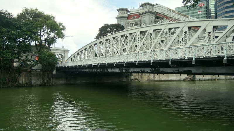 a white metal bridge spanning over a large river