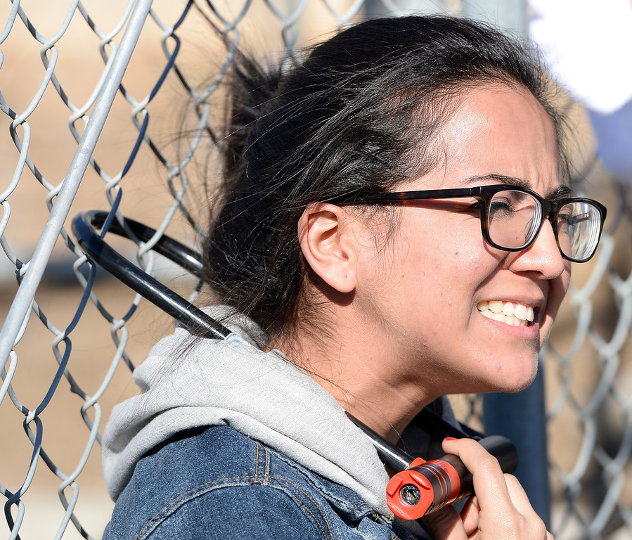 . Lizeth Montiel, 20 from Riverside, locks herself to the prison gates at the Adelanto Detention Facility East Monday. Over 100 protesters took part in a peaceful rally Monday November 25, 2013 at the privately owned Adelanto Detention Facility in Adelanto, Calif. The protesters, with the Inland Empire Immigrant Coalition, were protesting  to demand the release of three prisoners on ICE holds who they say shouldn\'t be incarcerated because they\'re infractions were minor and they\'ve been in too long already. It comes in the wake of highly critical report recently released by the nonprofit Detention Watch Network, detailing alleged abuses and civil rights violations of prisoners at the Adelanto facility and nine similar institutions nationwide.(Will Lester/Inland Valley Daily Bulletin)