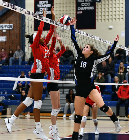 11/7/2019 Mike Orazzi | StaffrBristol Eastern's Leah Chipman (18) and Conard High School's Trude Davis (22) and Isabella Pincince (15) during the CCC girls volleyball tournament at Avon High School on Thursday. r