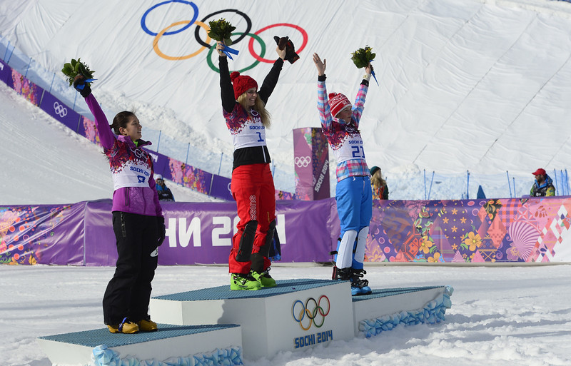 . (L-R) Silver Medallist, Japan\'s Tomoka Takeuchi; Gold Medallist, Switzerland\'s Patrizia Kummer; and Bronze Medallist, Russia\'s Alena Zavarzina celebrate at the Women\'s Snowboard Parallel Giant Slalom Flower Ceremony at the Rosa Khutor Extreme Park during the Sochi Winter Olympics on February 19, 2014.  JAVIER SORIANO/AFP/Getty Images