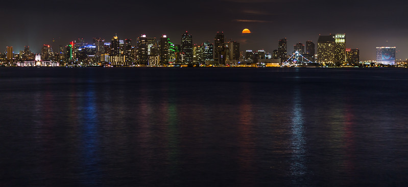 Orange-colored Bull Moon rises among San Diego skyline. Take 2.