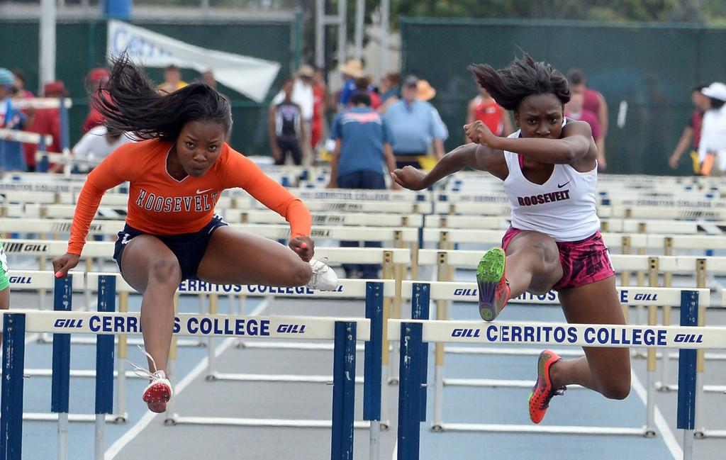. Roosevelt\'s Jasmyne Graham, left, with Jaela Williams compete in the division 1 100 meter high hurdles during the CIF Southern Section track and final Championships at Cerritos College in Norwalk, Calif., Saturday, May 24, 2014.   (Keith Birmingham/Pasadena Star-News)