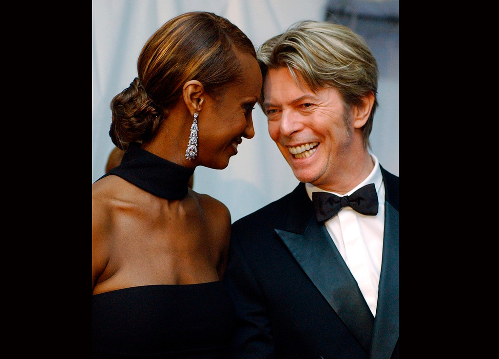 . FILE - In this June 3, 2002, file photo, Iman, left, and her husband, singer David Bowie arrive at the Council of Fashion Designers of America Fashion Awards in New York. Bowie, the innovative and iconic singer whose illustrious career lasted five decades, died Monday, Jan. 11, 2016, after battling cancer for 18 months. He was 69. (AP Photo/Suzanne Plunkett, File)
