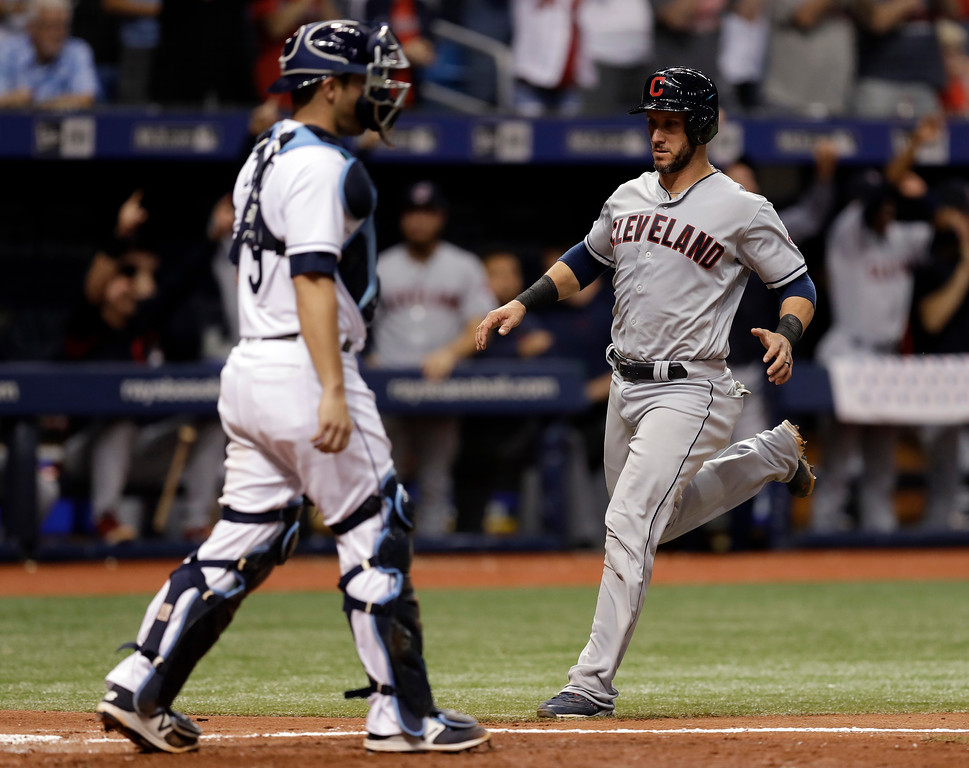 . Cleveland Indians\' Yan Gomes, right, scores in front of Tampa Bay Rays catcher Nicholas Ciuffo on a two-run double by Brandon Guyer off pitcher Adam Kolarek during the sixth inning of a baseball game Monday, Sept. 10, 2018, in St. Petersburg, Fla. (AP Photo/Chris O\'Meara)