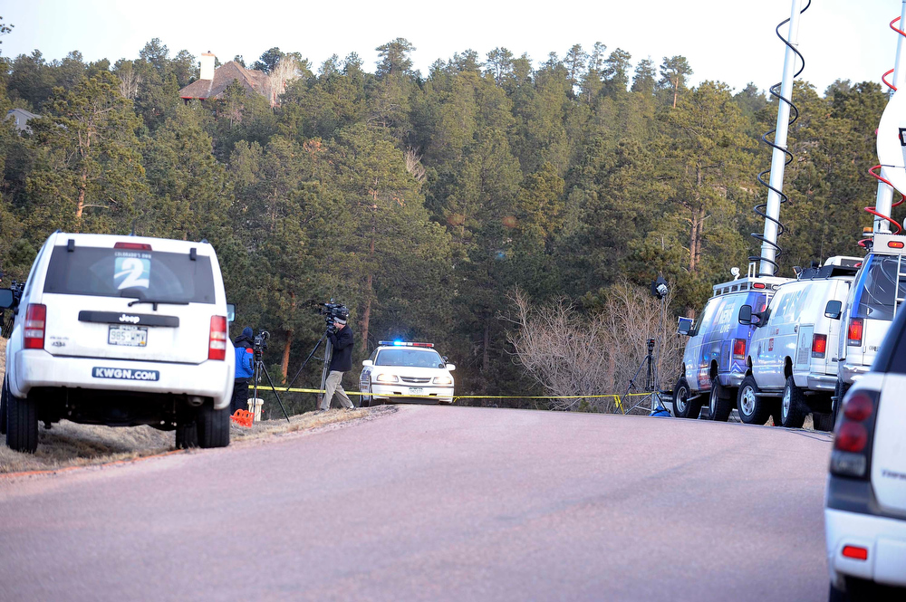 . Media vehicles congregate on Colonial Park Dr. east of Monument near the home of Tom Clements, executive director of the Colorado Dept. of Corrections, who was shot and killed at his front door Tuesday night. (Photo By Steve Nehf / The Denver Post)