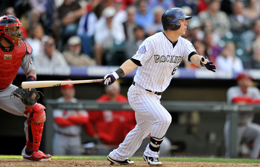 . Colorado Rockies\' Corey Dickerson, right, runs out an RBI-triple against St. Louis Cardinals relief pitcher Trevor Rosenthal during the eighth inning of a baseball game on Thursday, Sept. 19, 2013, in Denver. (AP Photo/Jack Dempsey)