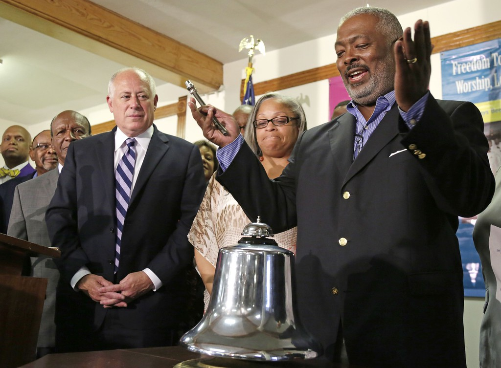 """. Illinois Gov. Pat Quinn left, and Chicago Alderman Deborah Graham, watch as Rev. James Moody finishes ringing a bell at 3:00 PM eastern time to commemorate the 50th anniversary of Dr. Martin Luther King\'s \""""I Have a Dream\"""" speech at Quinn Chapel AME Church Wednesday, Aug. 28, 2013, in Chicago. King gave his famous speech 50 years ago today during the march on Washington. Quinn Chapel AME Church is Illinois\' oldest African American congregation and King once spoke from the pulpit there. (AP Photo/M. Spencer Green)"""
