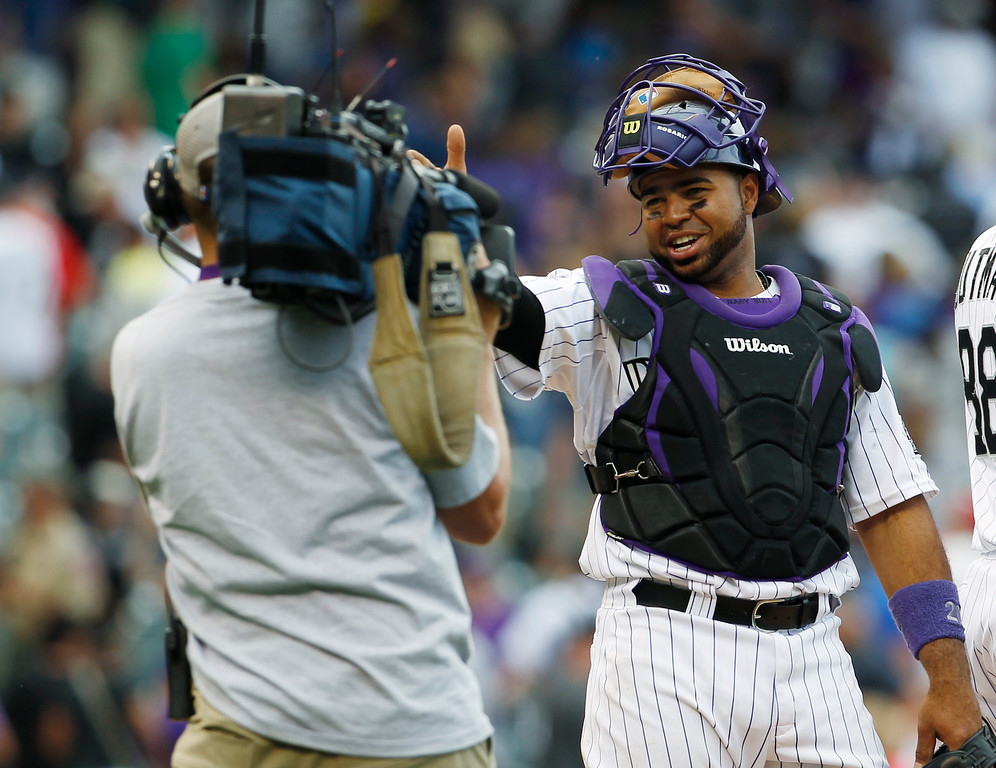. Colorado Rockies catcher Wilin Rosario gestures to the television cameraman their 10-5 victory over the Philadelphia Phillies in a baseball game in Denver on Saturday, June 15, 2013. Rosario collected three hits and drove in two runs in the game. (AP Photo/David Zalubowski)