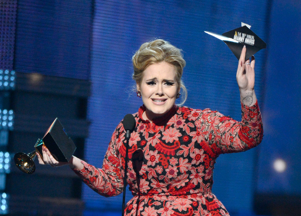". Singer Adele accepts Best Pop Solo Performance for ""Set Fire to the Rain (Live)\"" onstage at the 55th Annual GRAMMY Awards at Staples Center on February 10, 2013 in Los Angeles, California.  (Photo by Kevork Djansezian/Getty Images)"