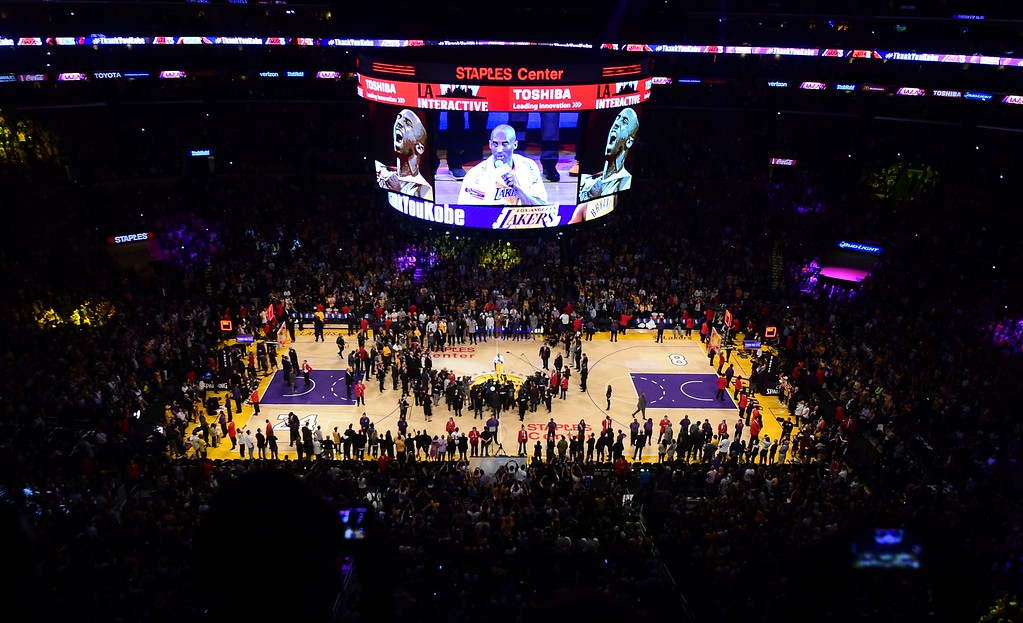 . Kobe Bryant of the Los Angeles Lakers addresses the fans following his final game as a Laker in their season-ending NBA western division matchup aginst the Utah Jazz in Los Angeles, California on April 13, 2016, where the Lakers defeated the jazz 101-96. / AFP PHOTO / FREDERIC J. BROWNFREDERIC J. BROWN/AFP/Getty Images