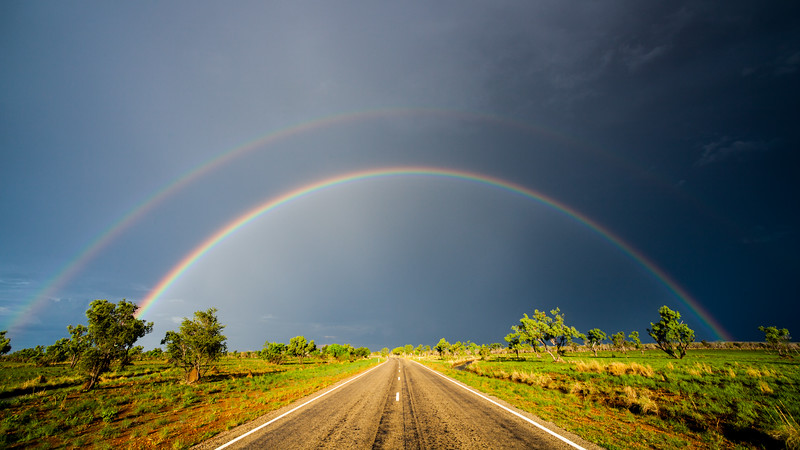 Double rainbow over a road in Northern Australia (Storm Chasing in Northern Australia for BBC Wonders of The Monsoon.)