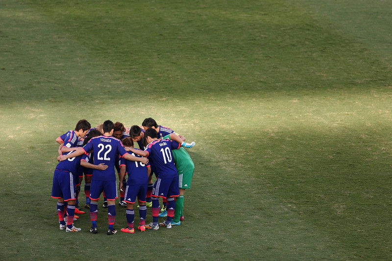 . The Japanese team huddle during the 2014 FIFA World Cup Brazil Group C match between Japan and Colombia at Arena Pantanal on June 24, 2014 in Cuiaba, Brazil.  (Photo by Warren Little/Getty Images)