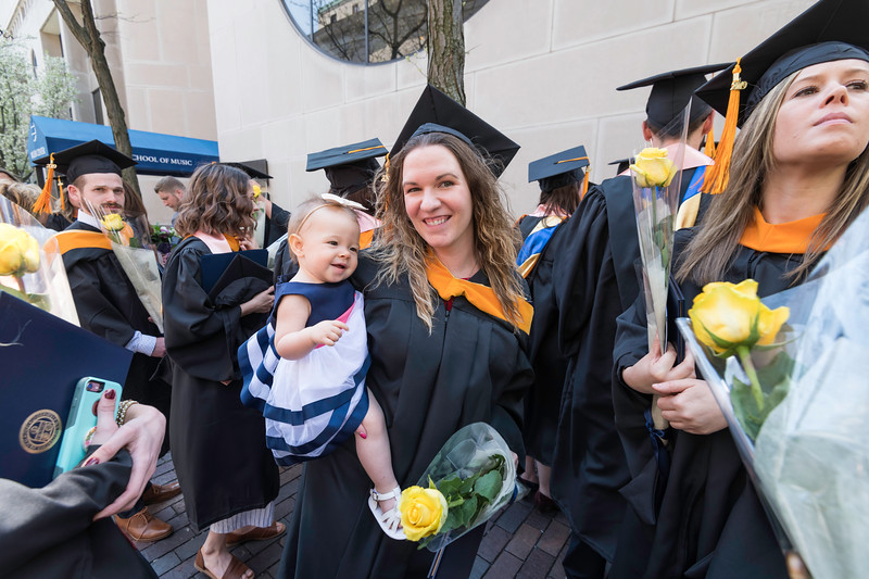 Amanda Irvine celebrates with her daughter, Layla (10 mos.) after the ceremony. // University of Rochester School of Nursing Commencement, Kodak Hall at Eastman Theatre May 17, 2019.  // photo by J. Adam Fenster / University of Rochester