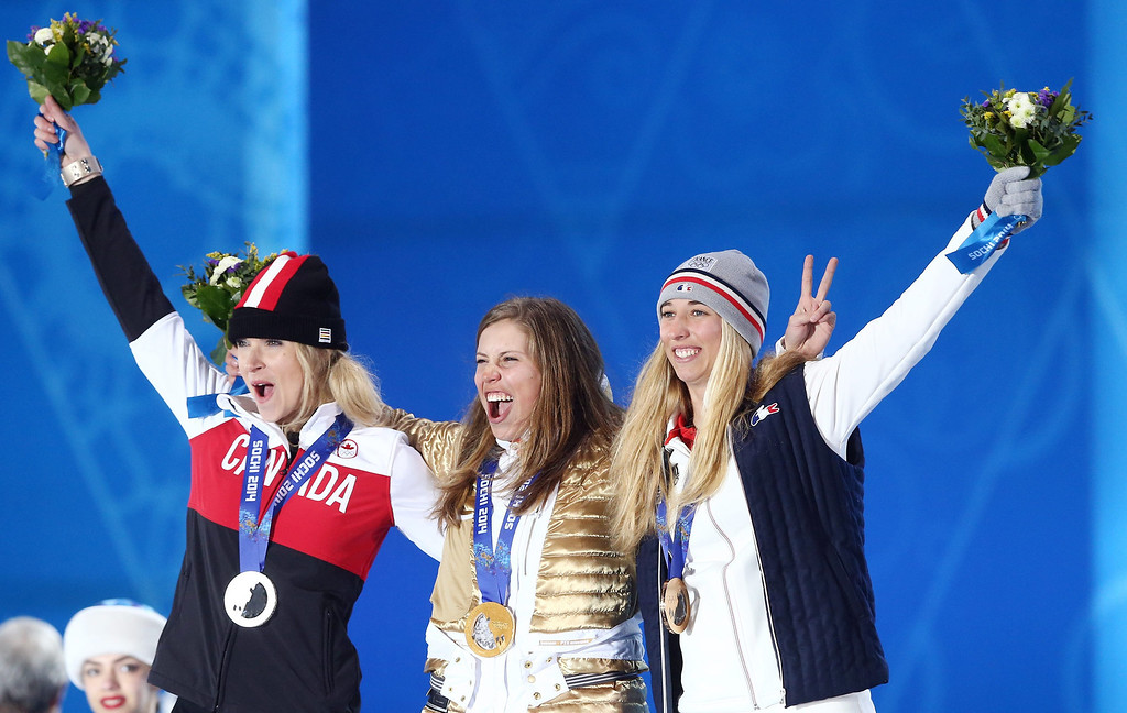 . Gold medalist Eva Samkova (C) of the Czech Republic is flanked by silver medalist Dominique Maltais (L) of Canada and bronze winner Chloe Trespeuch of France during the medal ceremony for Women\'s Snowboard Cross event at the Sochi 2014 Olympic Games, Sochi, Russia, 16 February 2014.  EPA/SRDJAN SUKI
