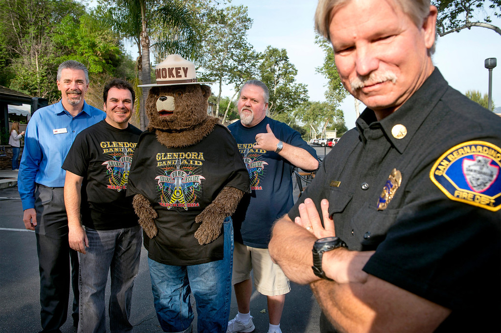 . Glendora Chamber of Commerce executive director Joe Cina, from left, Foothill Musicians Giving Back Chuck Castellanos and Michael Beatty with Smokey the Bear were at the Clubhouse 66 restaurant serving a pancake breakfast in appreciation to those that fought the Colby Fire in Glendora March 20, 2014.  (Staff photo by Leo Jarzomb/San Gabriel Valley Tribune)