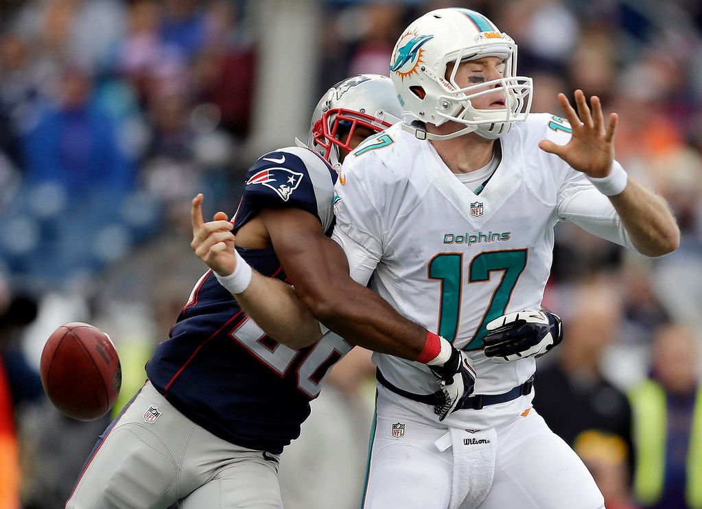 . New England Patriots defensive back Logan Ryan, left, strips the ball from Miami Dolphins quarterback Ryan Tannehill (17) in the second half of an NFL football game on Sunday, Oct. 27, 2013, in Foxborough, Mass. (AP Photo/Steven Senne)