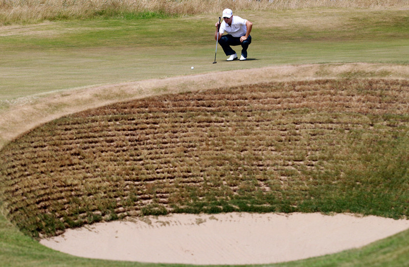 . Zach Johnson of the United States looks at his ball on the 13th green during the first round of the British Open Golf Championship at Muirfield, Scotland, Thursday July 18, 2013. (AP Photo/Peter Morrison)