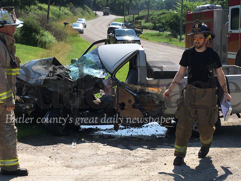 Lick Hill volunteer firefighters respond to two-pickup crash Friday morning in Summit Township.