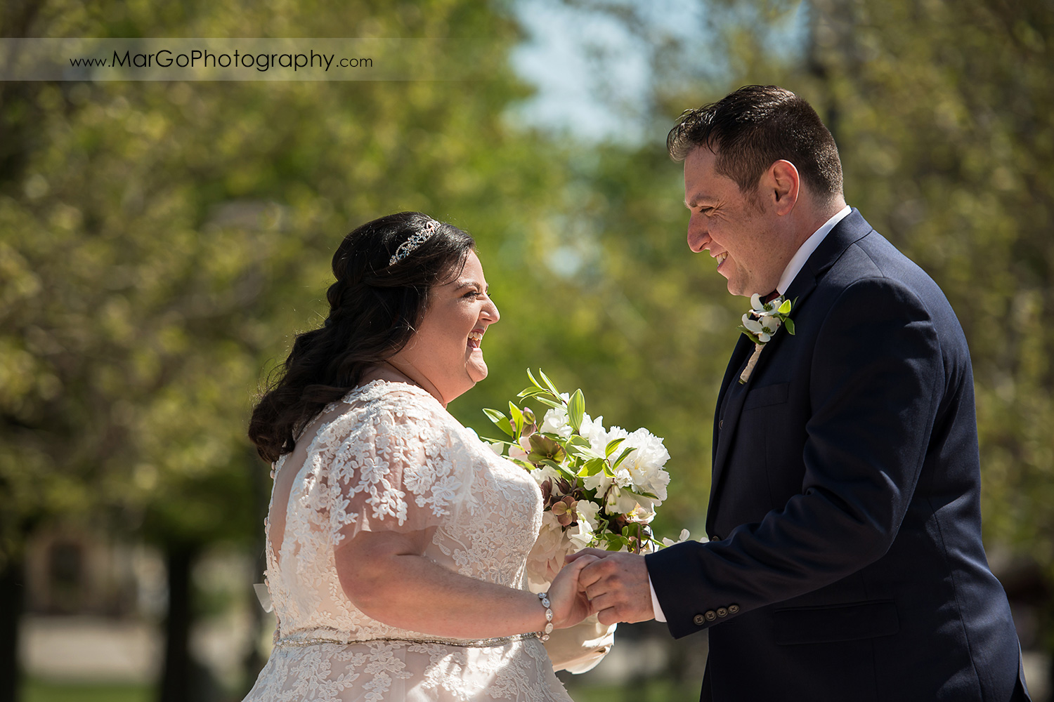 bride and groom holding hands and laughing at Livermore Garre Vineyard and Winery