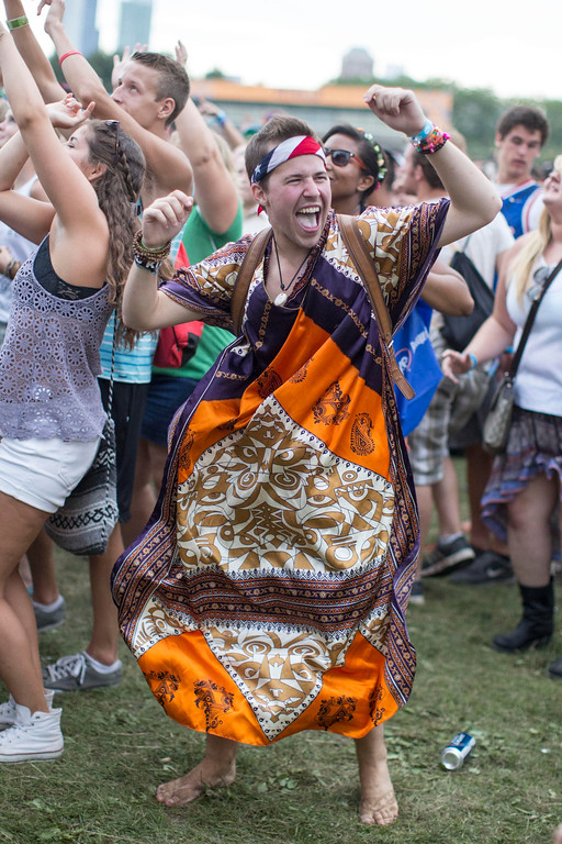 . Wade Shields of Chicago dances during Vampire Weekend\'s performance at the Lollapalooza Festival in Chicago, Sunday, Aug. 4, 2013. The more than two-decade-old festival opened Friday in Chicago\'s lakefront Grant Park. (AP Photo/Scott Eisen)
