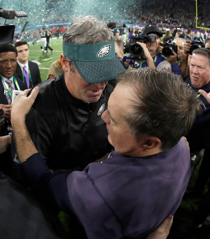 . Philadelphia Eagles head coach Doug Pederson, left, hugs New England Patriots head coach Bill Belichick after the NFL Super Bowl 52 football game Sunday, Feb. 4, 2018, in Minneapolis. The Eagles won 41-33. (AP Photo/Matt Slocum)