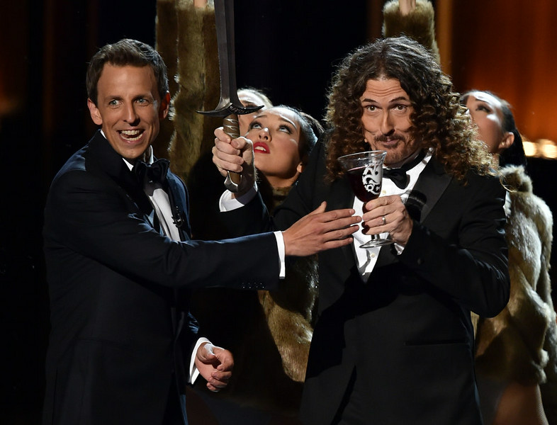 . Host Seth Meyers (L) and singer/songwriter \'Weird Al\' Yankovic onstage at the 66th Annual Primetime Emmy Awards held at Nokia Theatre L.A. Live on August 25, 2014 in Los Angeles, California.  (Photo by Kevin Winter/Getty Images)