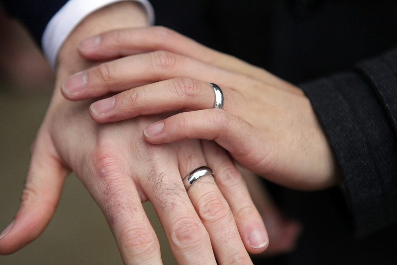 . Bernie Liang, left, and Ryan Hamachek, show their rings after getting married outside Seattle City Hall in Seattle, Washington December 9, 2012. Washington made history last month as one of three U.S. states where marriage rights were extended to same-sex couples by popular vote, joining Maryland and Maine in passing ballot initiatives recognizing gay nuptials.  REUTERS/Cliff Despeaux