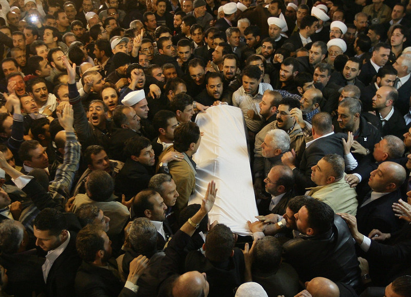. The coffin of Sunni Muslim cleric Mohamed Saeed al-Bouti, who died in a suicide bomb attack, is carried during his funeral ceremony on March 23, 2013 at the Omayyad mosque in Damascus, Syria. The suicide bomb attack in a mosque in Damascus has killed 42 people on March 21, including Saeed al-Bouti, wounding dozens of others, Syrian health ministry said.  AFP PHOTO/LOUAI BECHARA